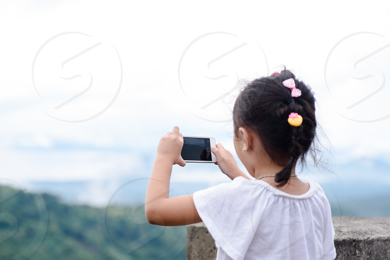 mobile phone mobile photography little girl technology phone outdoor people photo
