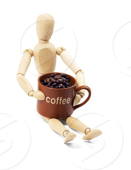 wood mannequin and coffee cup isolated on white background photo