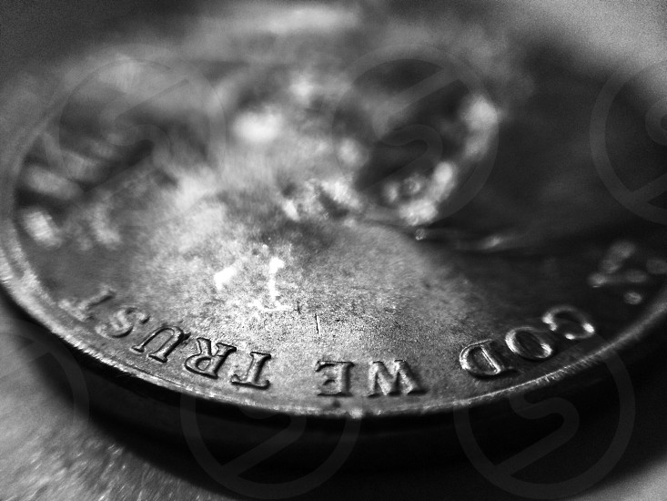 round in god we trust coin photo