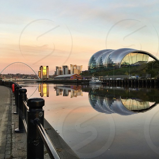 Gateshead Millennium Bridge The Sage music venue Baltic Centre For Contemporary Art and the river Tyne at sunset photo