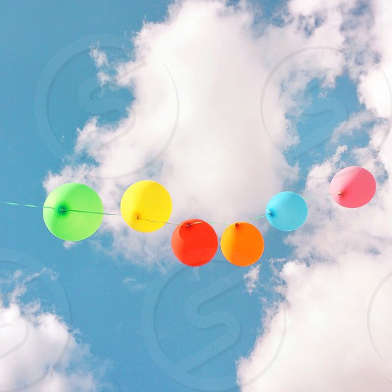 multicolored balloons with white clouds photo