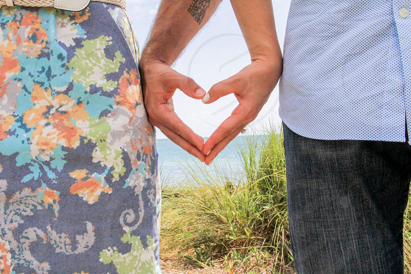 Heart hands of a couple in love photo