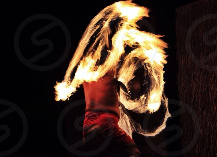 Fire sword dancer at a luau on Maui photo