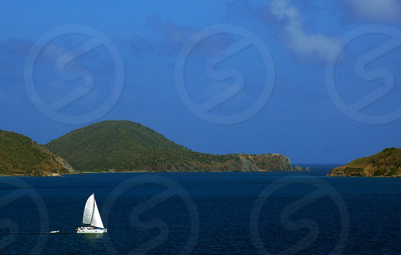 white sailing boat in the middle of the ocean photo