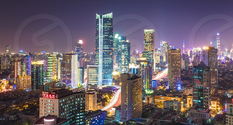 The colorful illuminated City of Shanghai at night with skyscrapers photo