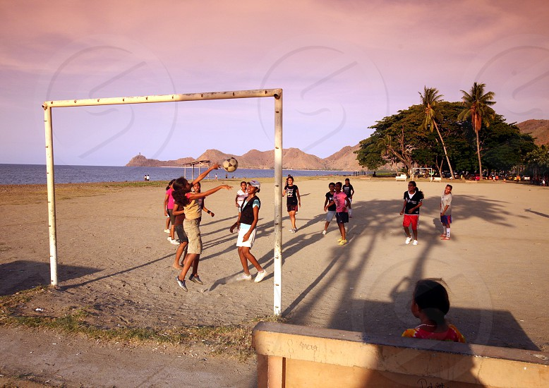 women play soccer at the coast and beach at the city of Dili in the south of East Timor in southeastasia.