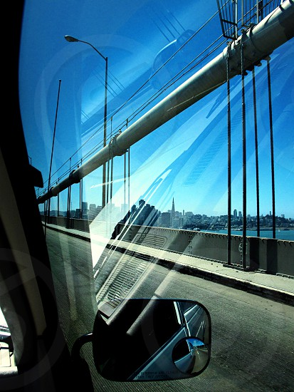 View of Downtown San Francisco from a car window driving on the Bay Bridge photo
