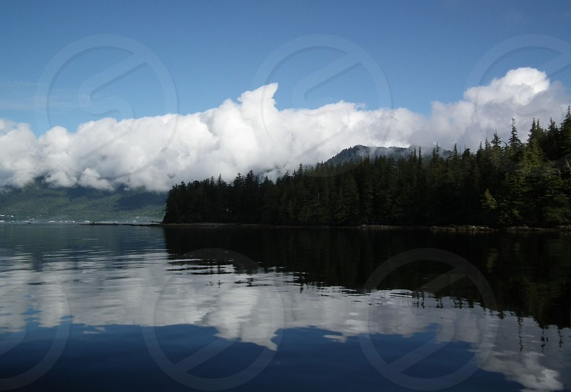 clouds reflected in water photo