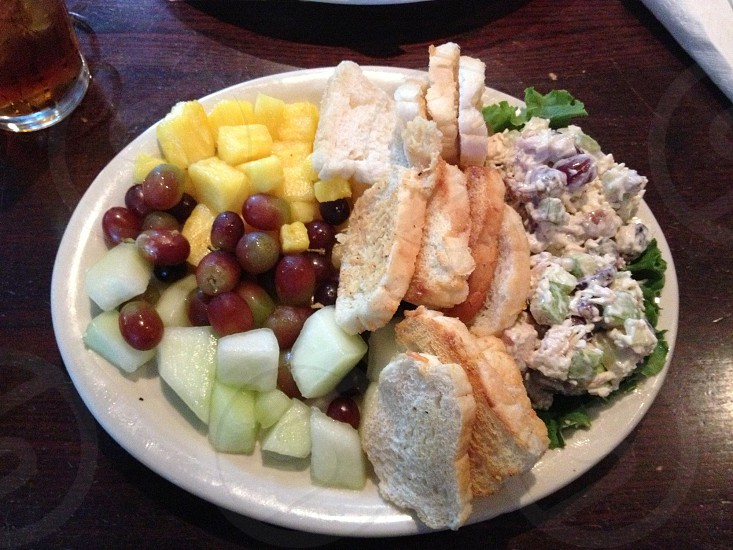 Chicken salad plate with melon grapes pineapple and croutons photo