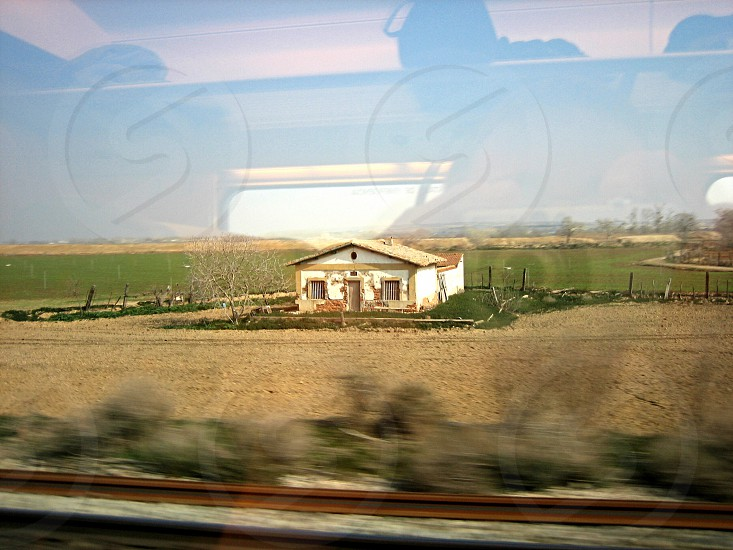 Spanish countryside taken from moving train. Some glare photo