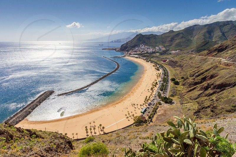 "Here's a bird-eye view of a famous beach called in Spanish ""Playa de las Teristas"" near Santa Cruz de Tenerife on Tenerife island one the canary island. photo"