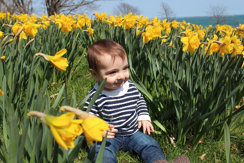 Baby toddler cute eye lashes baby boy happy flowers play photo