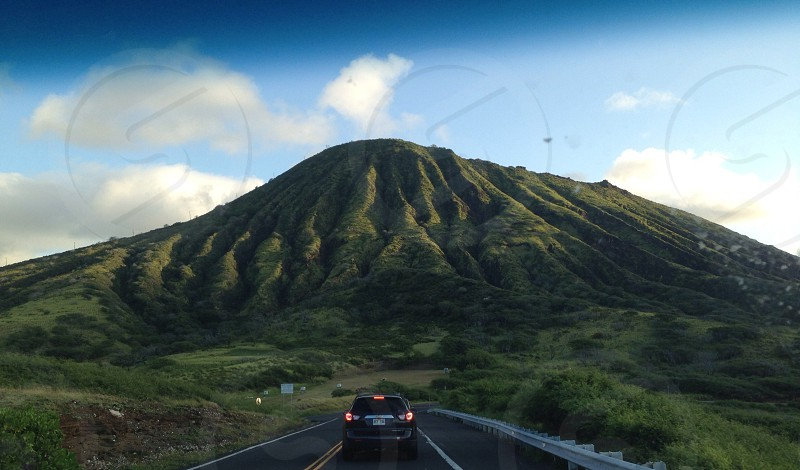 Car hill sky mountain volcano Hawaii road highway freeway green bright lush nature landscape blue summer spring color photo