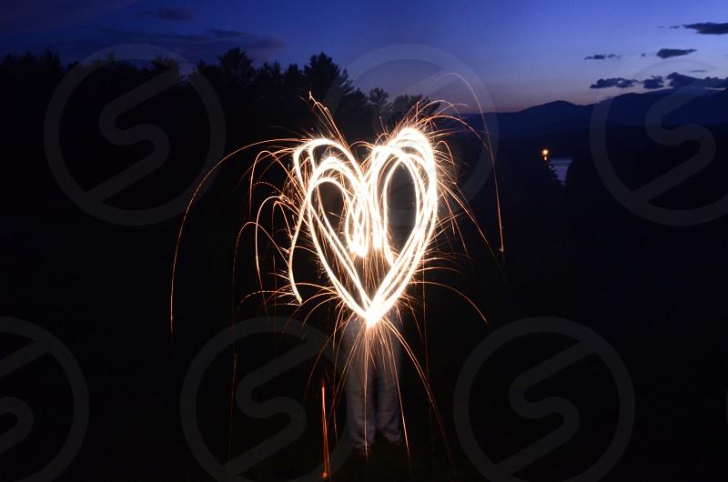 heart shape fireworks at dusk photo