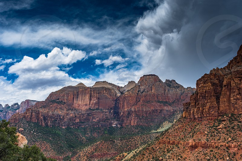 Zion national park nature view panorama rocks cliffs color landscapes mountain desert cloudsfoliage brush valley canyon  photo
