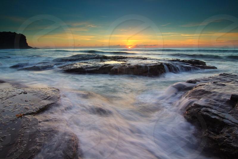 Beach waves rocks long exposure sunrise Australia  photo