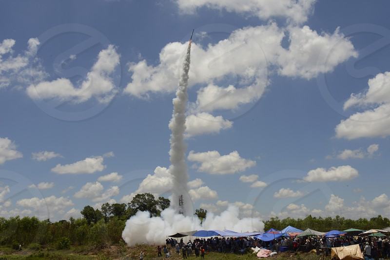 a rocket start at the traditonal rocket festival or Bun Bang Fai  in Ban Si Than in the Provinz Amnat Charoen in the northwest of Ubon Ratchathani in the Region of Isan in Northeast Thailand in Thailand.