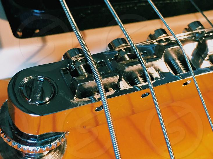 closeup photography of gray guitar part photo