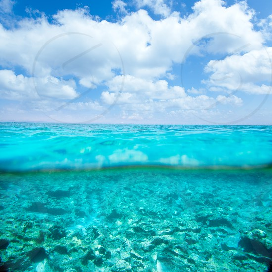 Belearic islands turquoise sea under over in out waterline tropical beach photo