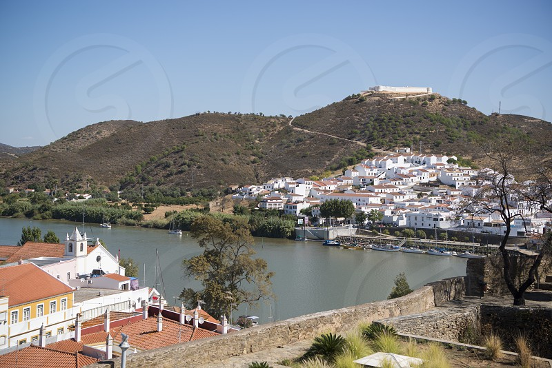 the town Alcoutim in Portugal and the town Sanlucar de Guadiana in Spain at the river Rio Guadiana on the Border of portugal and Spain at the east Algarve in the south of Portugal in Europe. photo
