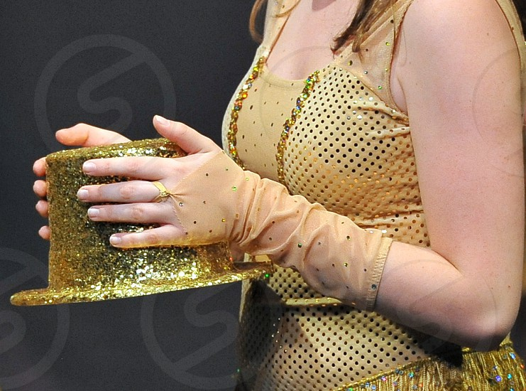 Hands of a Dancer holding a hat photo