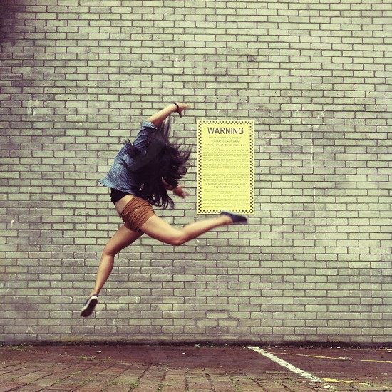 woman jumping macro photography photo