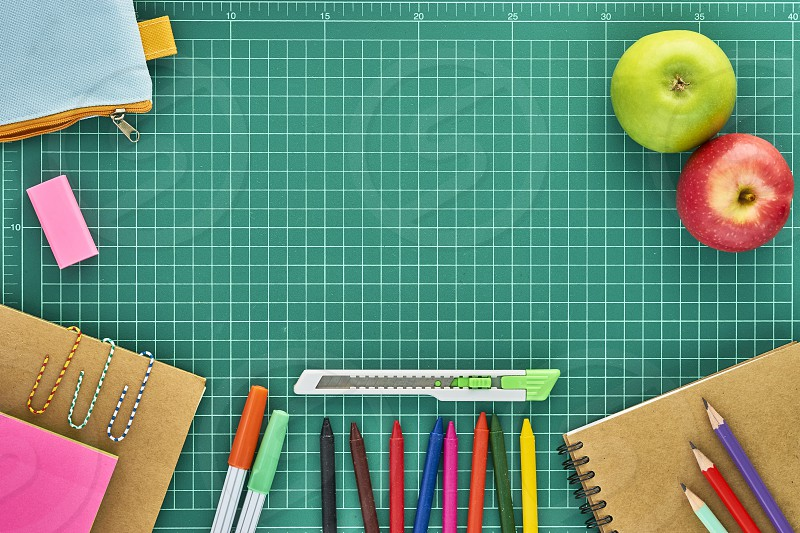 Recycled paper notebook School supplies on paper cutting board photo