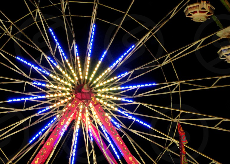 view of Ferris wheel with lights photo