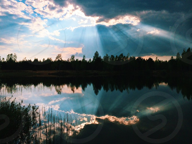 forest lake with sun rays photography photo