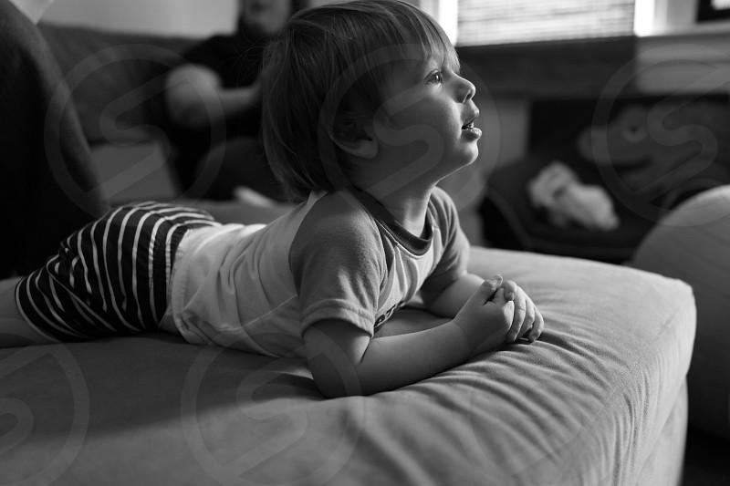 Child watching television. Kid watching TV.  photo
