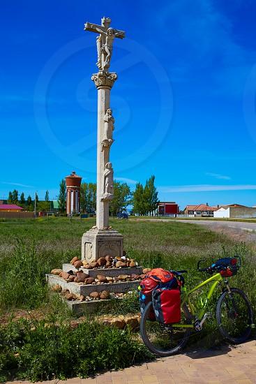 El burgo Ranero bike on column cross by Saint James Way in Leon Spain photo