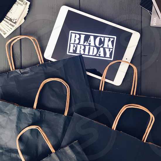 Black Friday shopping online shopping retail shopping shopping bags using technology sales sale  money cash business tablet lifestyle  credit card  photo