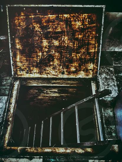 ladder through trap door photo