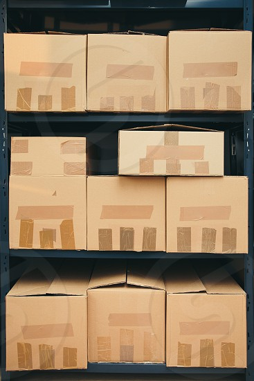 Cardboard boxes on shelves photo