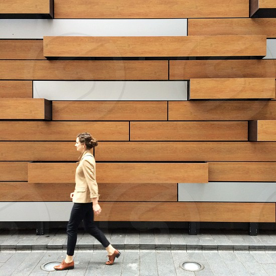 Woman walk wall shapes NYC photo