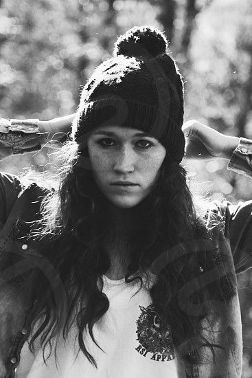 woman in gray jacket and black beanie photo