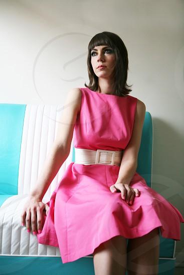 retro bright woman pretty pink hot pink sitting  photo