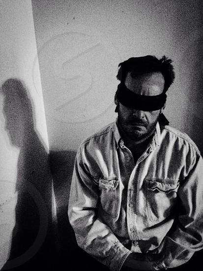 man in blind fold photo