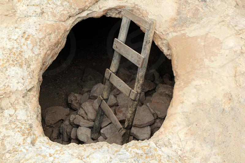 Barbaria cape cave hole aged wood steps magic Formentera island Balearic photo
