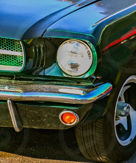 close up photography of classic ford mustang during daylight photo
