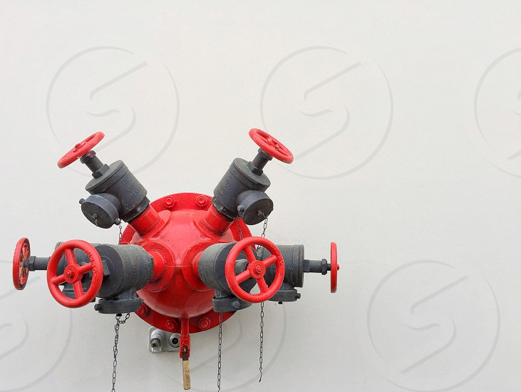 Fire hydrant fire hydrant red simple minimal circular warehouse wall safety fireman firemen photo
