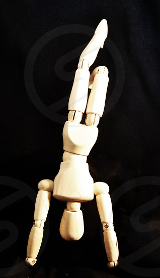Wooden Hand Stand Pose photo