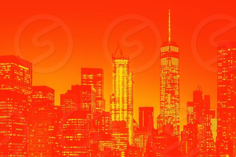 Night view of lower Manhattan skyline in New York. Orange and yellow duotone effect photo