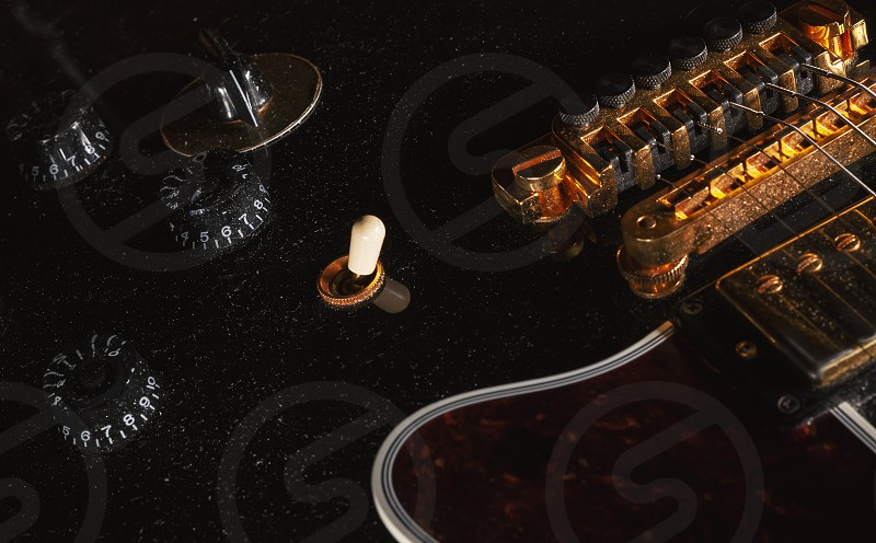 Details of an old dusty electric guitar. photo