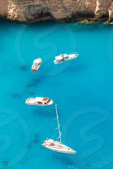 Boats On Turquoise Blue Sea photo