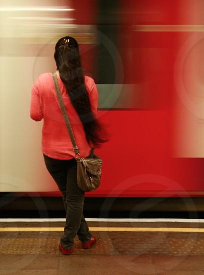 Mile End Tube stop London.  Metro underground motion blur long exposure red long hair photo