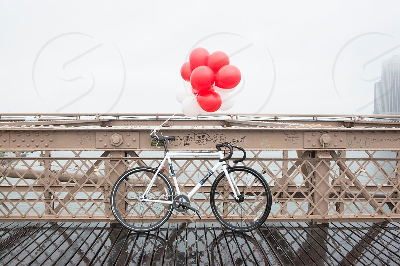 red balloons on bicycle photo