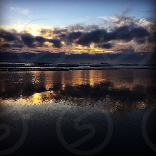 Sunset reflection at the Oregon Coast photo