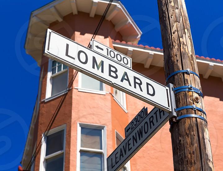 San francisco Lombard Street sign with Leavenworth California USA photo