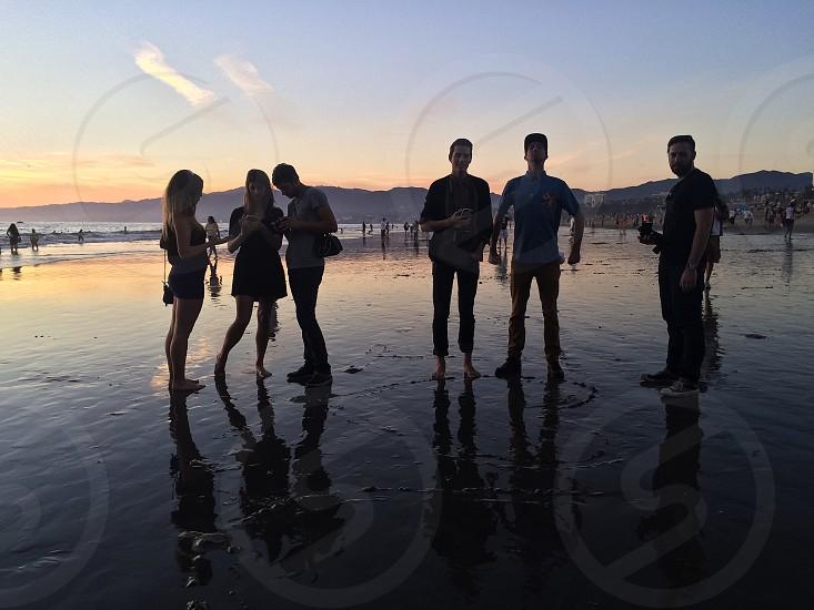 people standing on seashore photo